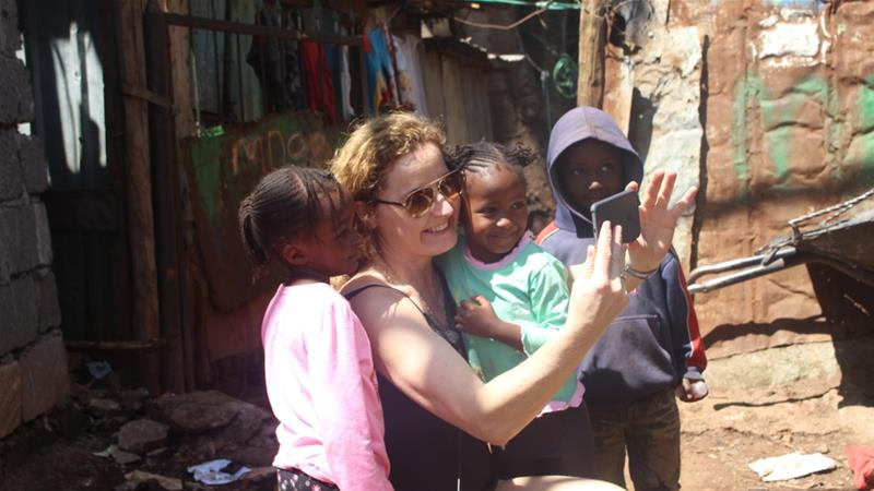 Lotte Rasmussen has toured Kibera more than 30 times, often bringing friends to tour the slum [Osman Mohamed Osman/Al Jazeera]