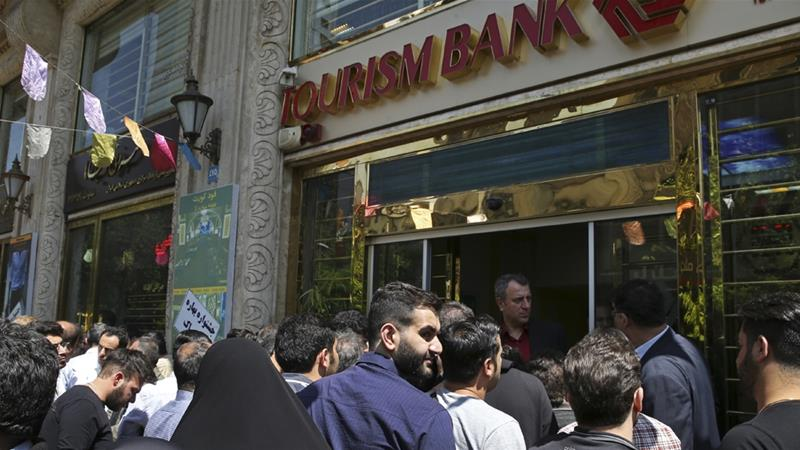 Iran's currency plunges to record low as US sanctions loom