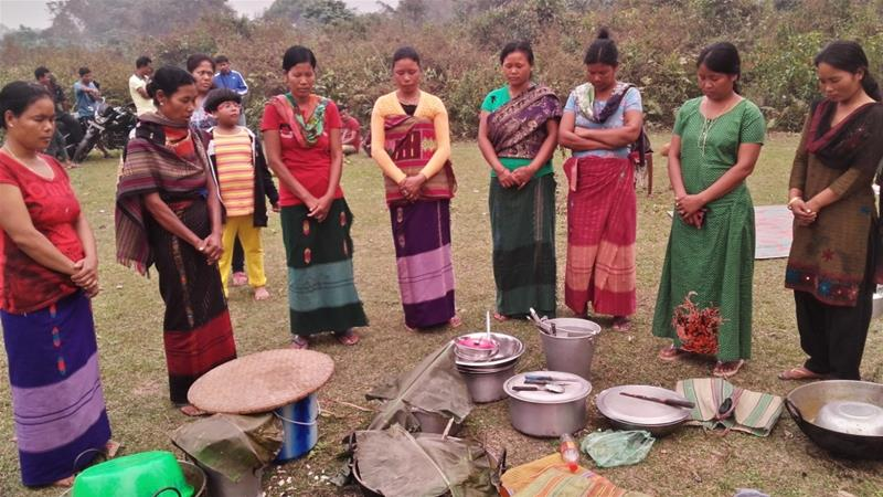Indigenous women from the Rabha tribe, pictured during prayer. Many Rabhas were evicted from the Buxa-Chilapata forests after the creation of a national park [Photo credit: Global Forest Coalition]