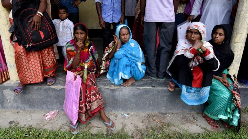 Villagers outside the NRC centre in Morigaon district to get their documents verified by officials [File: Reuters]