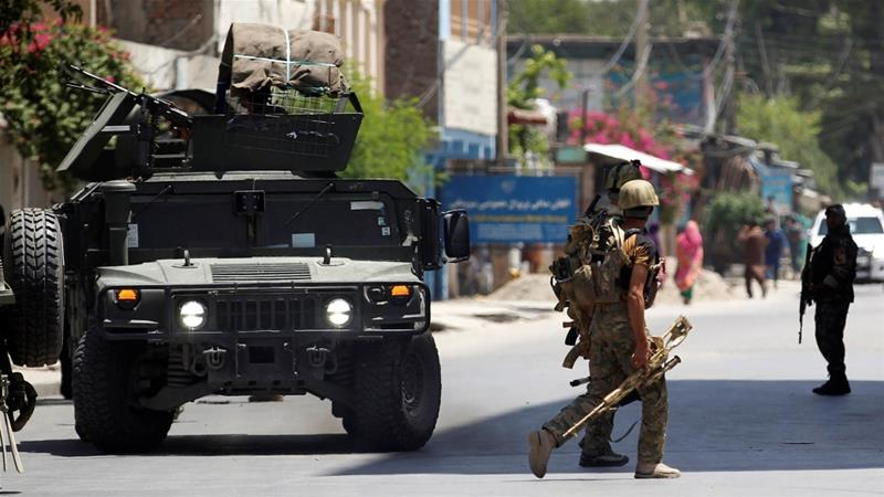 At least 15 dead as gunmen storm Afghan government building