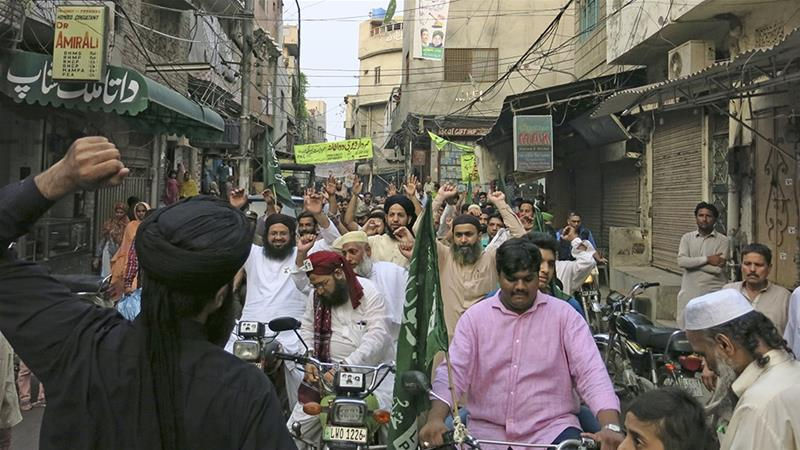 Dozens of TLP supporters take part in a motorycle rally through in the heart of the eastern city of Lahore [Asad Hashim/Al Jazeera]