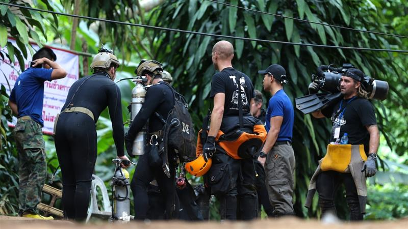 International divers prepare to enter the Tham Luang cave complex in Thailand to rescue a young football team and their coach trapped inside [File: Athit Perawongmetha/Reuters]