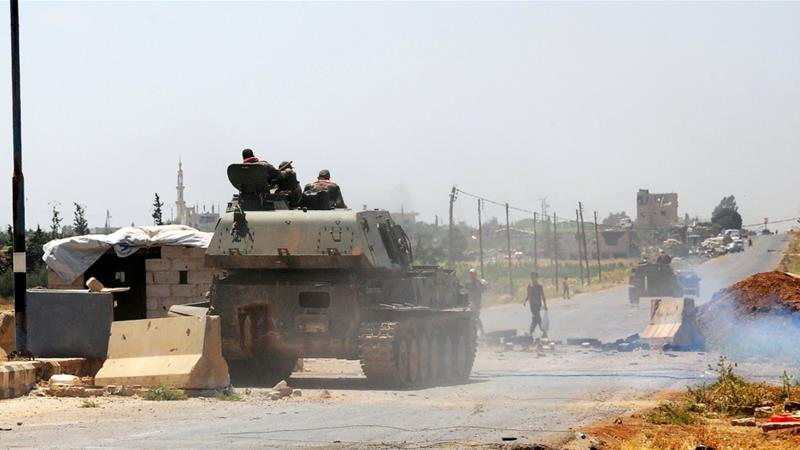 Syrian army raises flag in militant-held areas