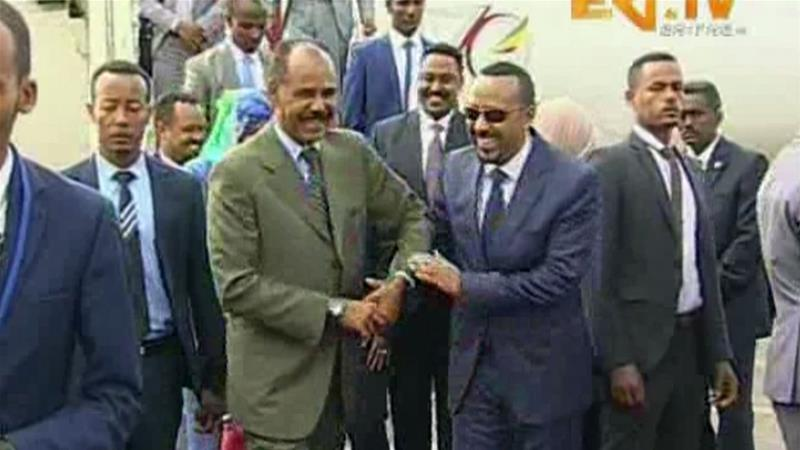 In this grab taken from video provided by ERITV, Ethiopia's PM Abiy Ahmed is welcomed by Erirea's President Afwerki as he disembarks the plane, in Asmara, Eritrea, Sunday, July 8, 2018 [ERITV via AP]