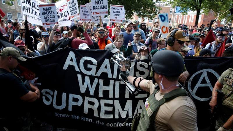 White nationalists are met by a group of counter-protesters in Charlottesville, Virginia, US, August 12, 2017 [Joshua Roberts/Reuters]