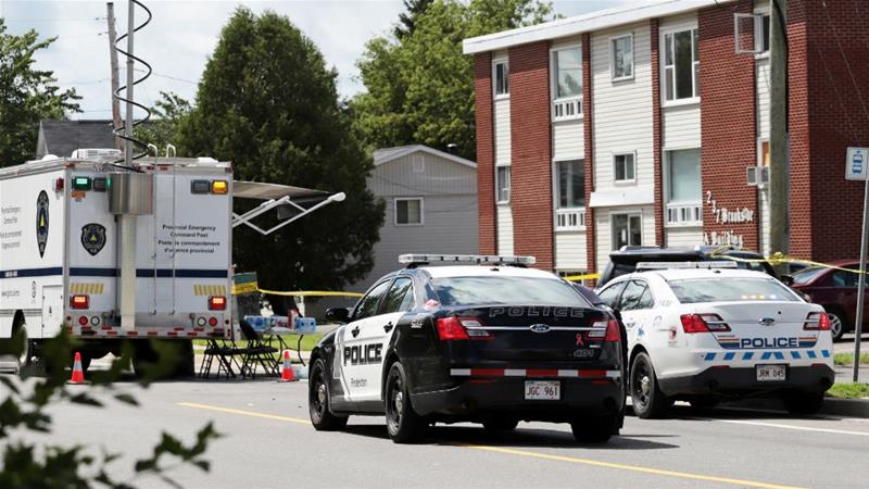 Police investigate the scene of a fatal shooting incident in Fredericton, New Brunswick, Canada [Dan Culberson/Reuters]