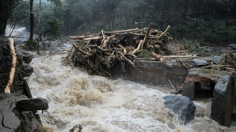 Landslides triggered by heavy monsoon rains have cut off road links and submerged several villages [AP]