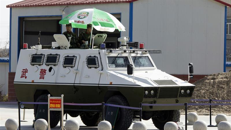 Paramilitary police patrol the airport in Hotan in western China's Xinjiang region [File: Ng Han Guan/AP]