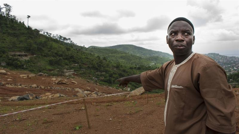 Mudslide victim Kalilu Daboh points to where his family home once was [Lilah Gaafar/Al Jazeera]