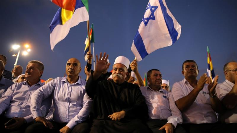 Leaders from the Druze minority take part in a rally to protest against Jewish nation-state law in Rabin square in Tel Aviv, Israel August 4, 2018 [Corinna Kern/Reuters]