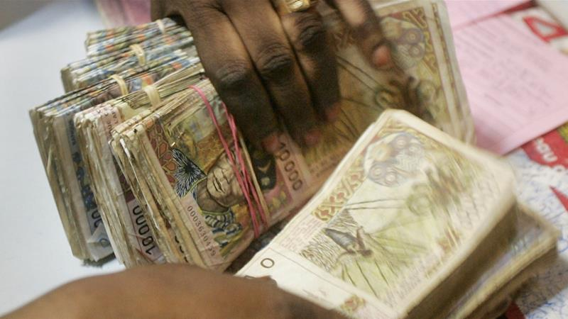 The CFA Francs, which are in reality two different currencies both guaranteed by the French Treasury, are still the official currencies in 14 West and Central African countries [AP Photo/Ben Curtis]