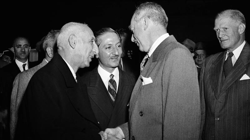 US Secretary of State Dean Acheson (R) greets Mossadegh upon the Iranian PM's arrival in Washington, DC for a talk with President Truman in 1951 [File: AP]