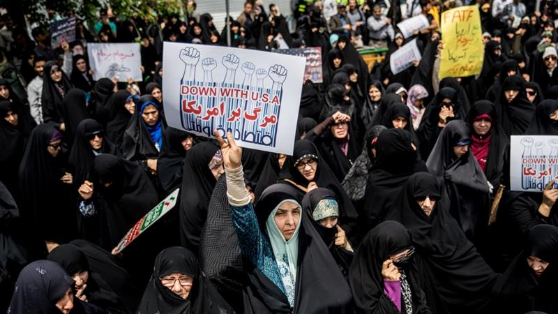 Iranian women gather during a protest against US President Donald Trump's decision to walk out of the 2015 nuclear deal in Tehran on May 11, 2018 [Tasnim News Agency vie Reuters]