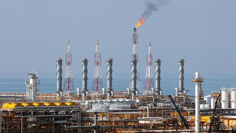 French oil giant would have been highly vulnerable to US penalties for remaining in Iran [Abedin Taherkenareh/EPA]