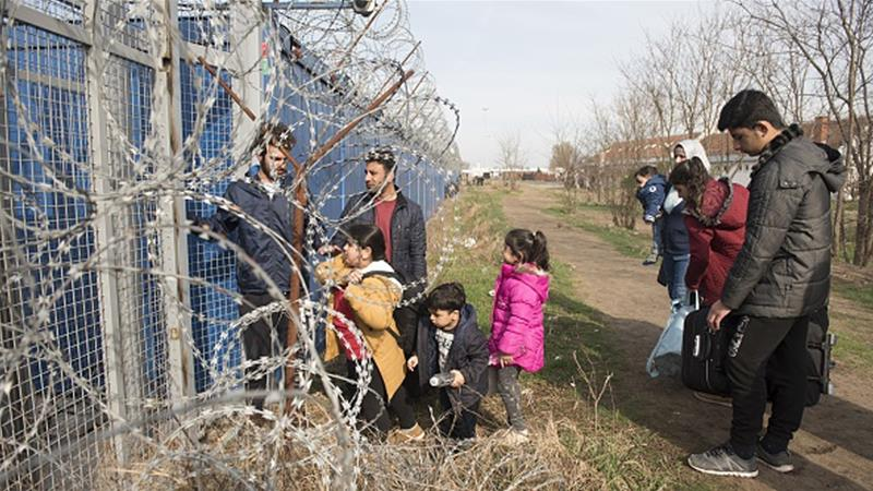 A Syrian family waits at the Kelebija border crossing in Serbia to claim asylum in Hungary [File: Omar Marques/Anadolu Agency/Getty Images]