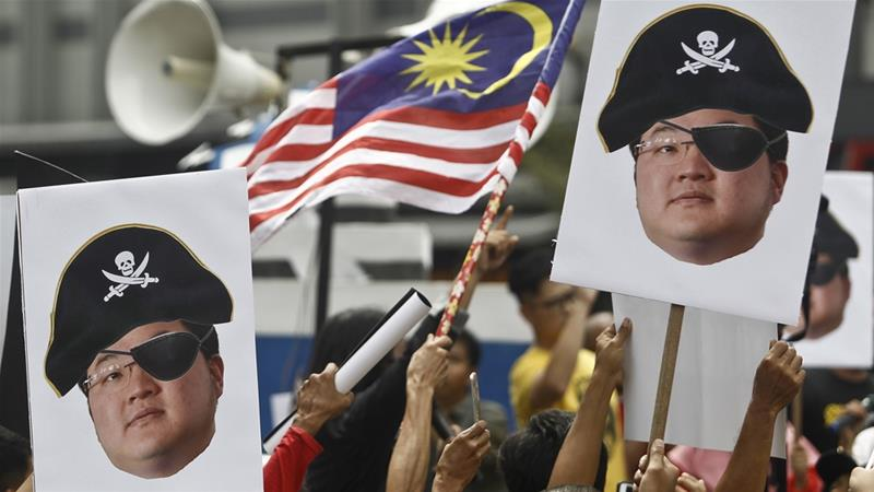 Anger against Jho Low and former Prime Minister Najib Razak over their alleged role in siphoning billions of dollars from state investment fund 1MDB contributed to the defeat of Najib's party in last year's elections [File: Sadiq Asyraf/AP]