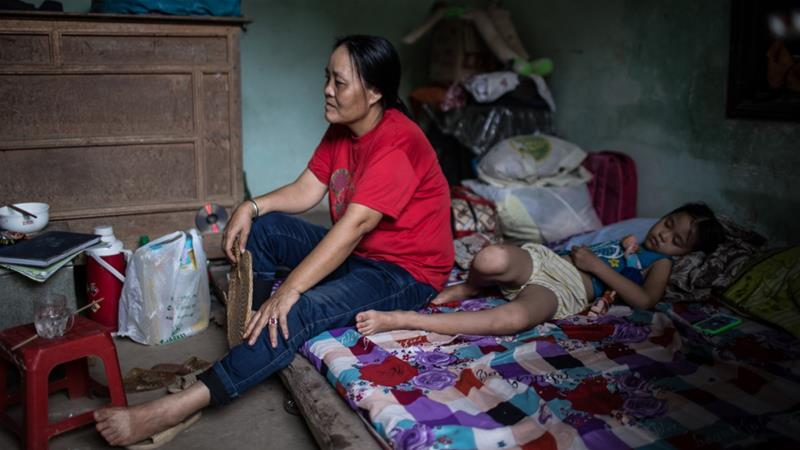 Pham Thi Dao, 46, says she worked more than 18 hours a day and was given the same one meal to live on - a slice of lamb and plain rice [Yen Duong/Al Jazeera]
