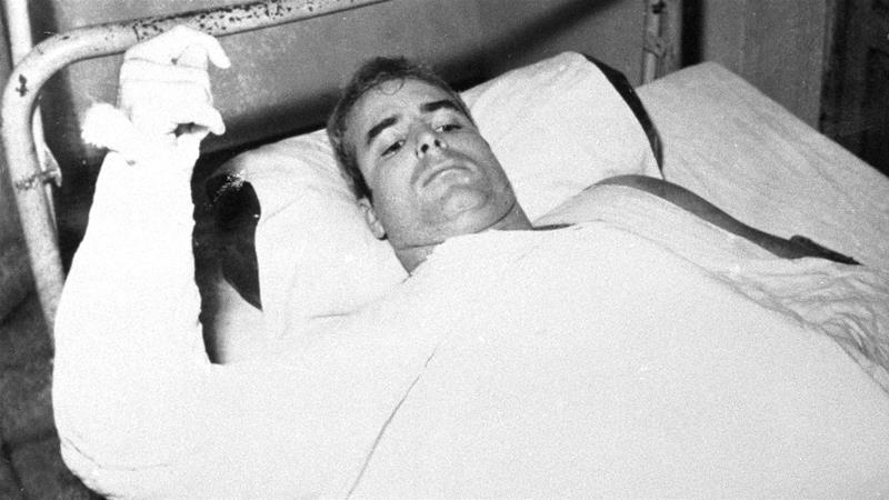 John S McCain is shown in this undated photo lying injured in North Vietnam wearing an arm cast. He was a held prisoner during the Vietnam War [AP Photo/CBS]