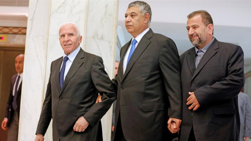 Egypt's intelligence chief Khaled Fawzi (c) with Hamas official Saleh Arouri (r) and Fatah leader Azzam Ahmad (l) ahead of the signing of a reconciliation deal in Cairo, on October 12, 2017 [Reuters]