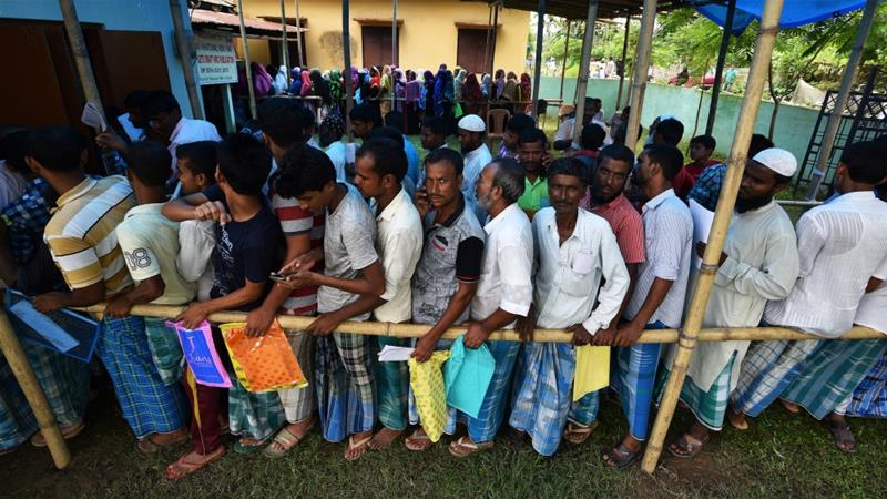 People wait in queue to check their names on the draft list at the National Register of Citizens (NRC) centre at a village in Nagaon district, Assam state, India, July 30, 2018 [Reuters]