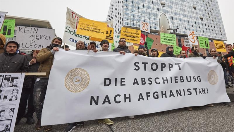 A sign reads 'Stop deportation to Afghanistan' at a Hamburg demonstration in February 2017 [Georg Wendt/DPA via the Associated Press]