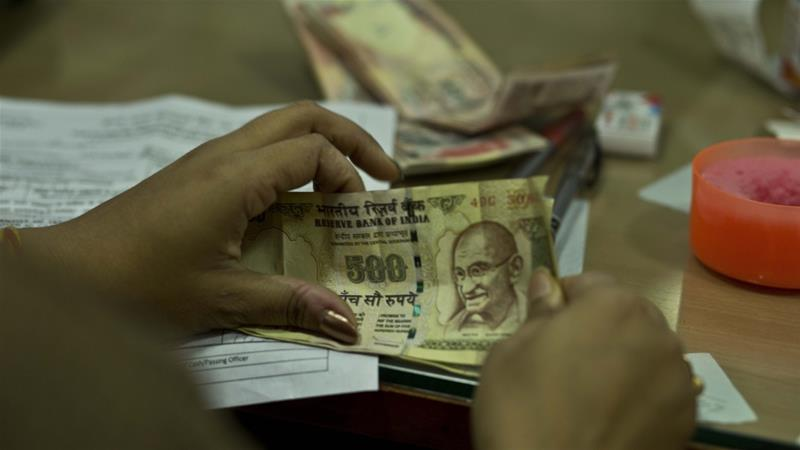India banned most of its currency bills from circulation without warning [Anupam Nath/AP]