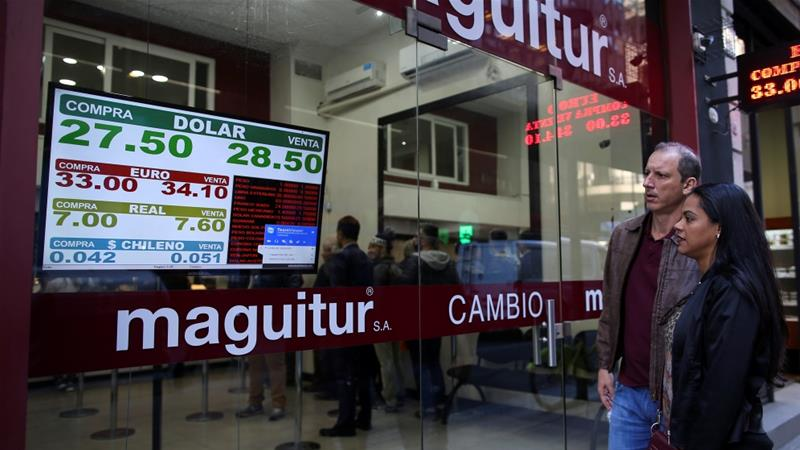 The Argentine peso dropped by 13.5 percent against the dollar on Thursday [Agustin Marcarian/Reuters]