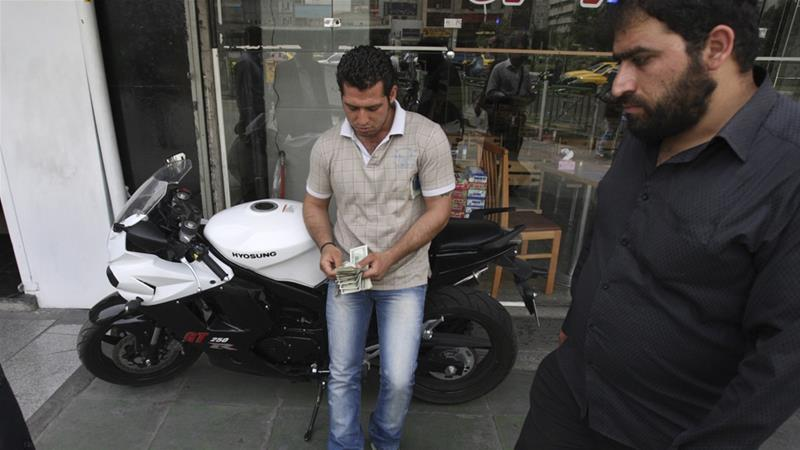 The Iranian currency, rial, has lost more than half its value in less than a year [File: AP]