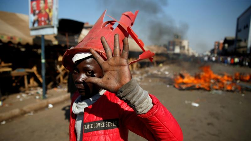 Supporters of the opposition Movement for Democratic Change party of Nelson Chamisa protest alleged election rigging in Harare, Zimbabwe on August 1, 2018 [Philimon Bulawayo/Reuters]