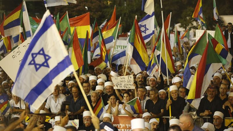It is estimated that more than 50,000 people partook in the Druze-led protests on Saturday. [Abir Sultan/EPA-EFE]
