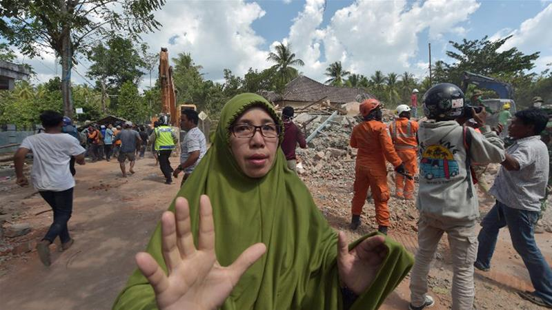 A woman reacts shortly after a 6.2-magnitude aftershock hit Tanjung on Thursday [Adek Berry/AFP]