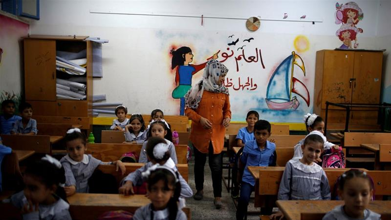 Many Palestinian children attend UNRWA-run schools in the Gaza Strip and West Bank [Mohammed Salem/Reuters]