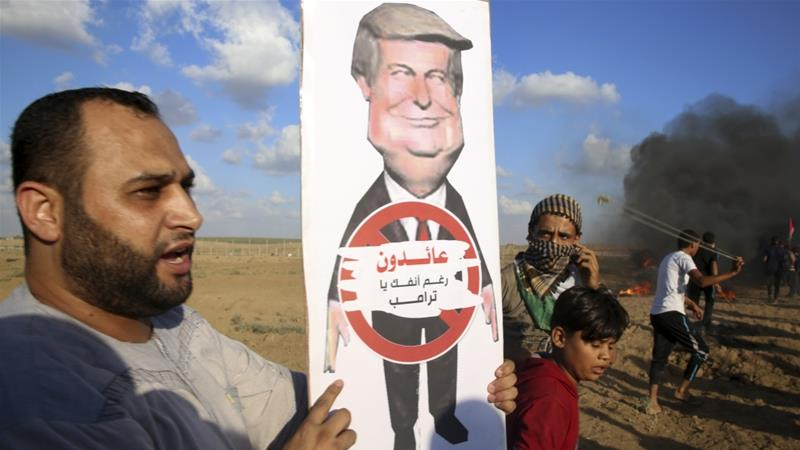 A protester holds a poster of President Donald Trump that reads: 'We are returning in spite of you, Trump' [File: Adel Hana/AP Photo]