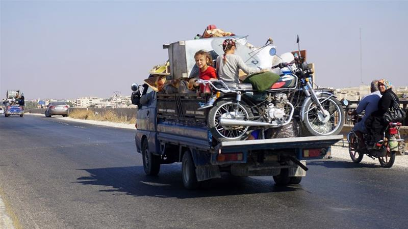 More than 30,000 people have fled their homes in northwest Syria since the bombardment resumed last week [Muhammad Haj Kadour/AFP]