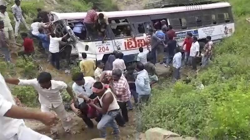 The bus was carrying pilgrims in the hills of south India when it plunged off a road [KK Production via AP Photo]