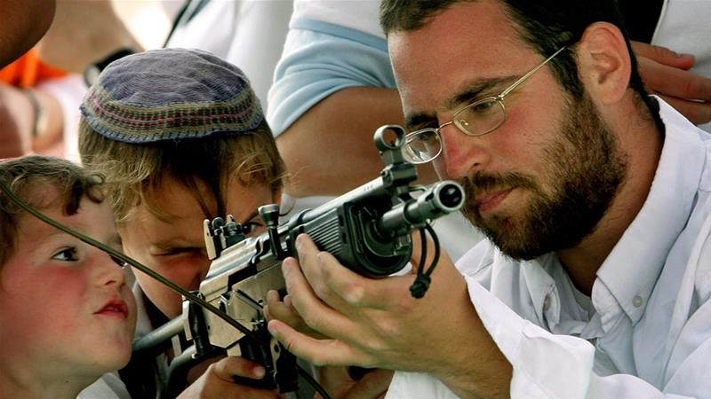 More than half a million Israelis have become eligible for gun permits under new firearms rules [File: Tsafrir Abayov/AP]