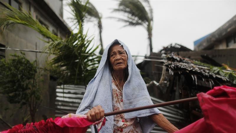 Mangkhut made landfall in the northeastern town of Baggao with winds of 205km/h [Francis R. Makasig/EPA]