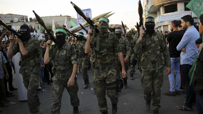 Members from al-Qassam Brigades, a military wing of Hamas, hold RPG launchers in Gaza [File AP Photo/Adel Hana]