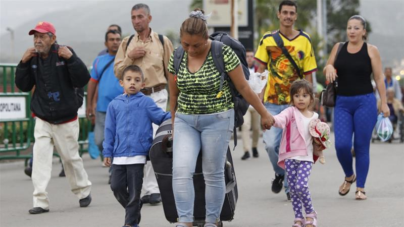Venezuelans line up at reopened border crossing with Colombia
