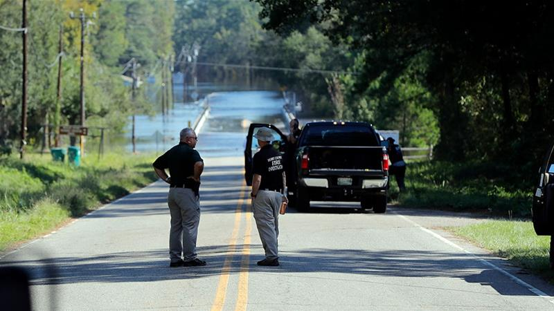 Responders congregate near where two people drowned Tuesday evening when they were trapped in a Horry County Sheriff transport van [Gerald Herbert/AP Photo]