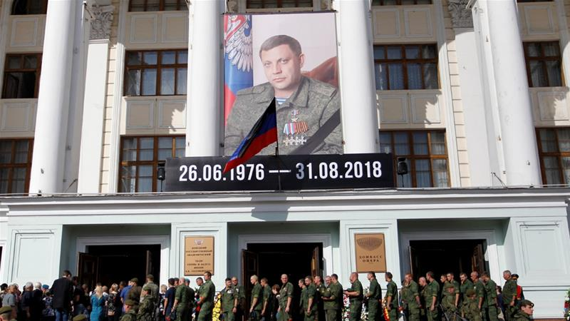 Tens of thousands gather for funeral of Ukrainian rebel leader