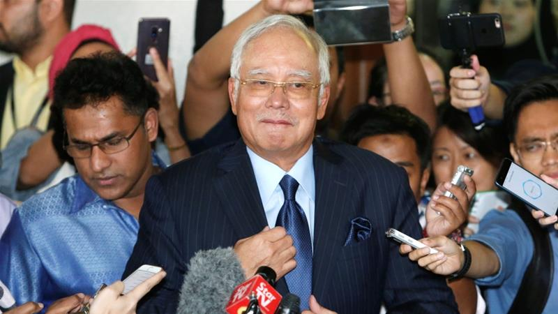 Malaysian ex-PM Najib hit with 25 new charges over 1MDB scandal