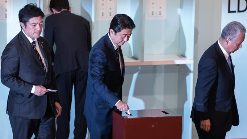 Japan's Shinzo Abe wins ruling party leadership vote
