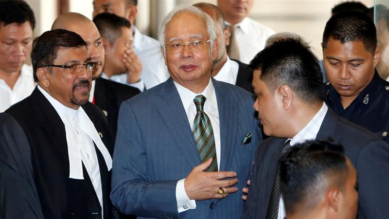 Malaysian prosecutors file 25 corruption charges against former PM