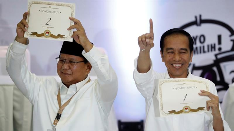Widodo [right] and his rival, Prabowo, battle for the support of Indonesia's roughly 80 million young voters [Reuters]