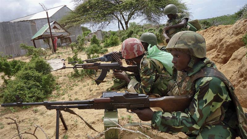 African Union soldiers take up positions in the Deynile district of Somalia's capital against al-Shabab [File: Ali Bashi/AP]
