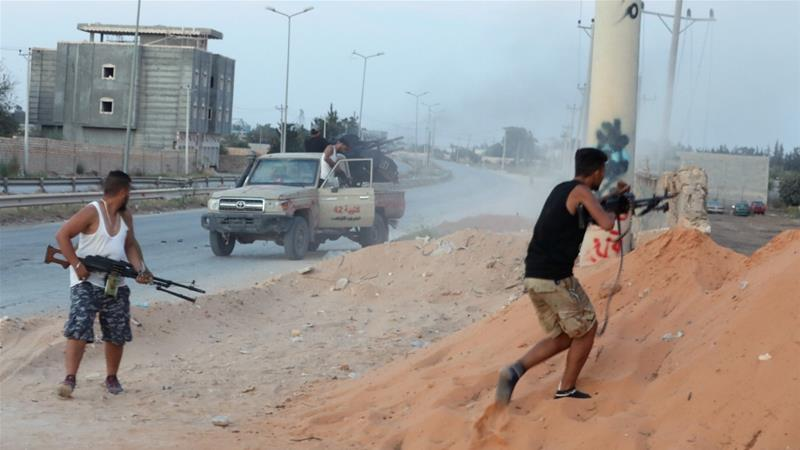 Fighting between a militia allied with Libya's internationally recognised government fight and two rival groups left some families trapped in their homes [Hani Amara/Reuters]