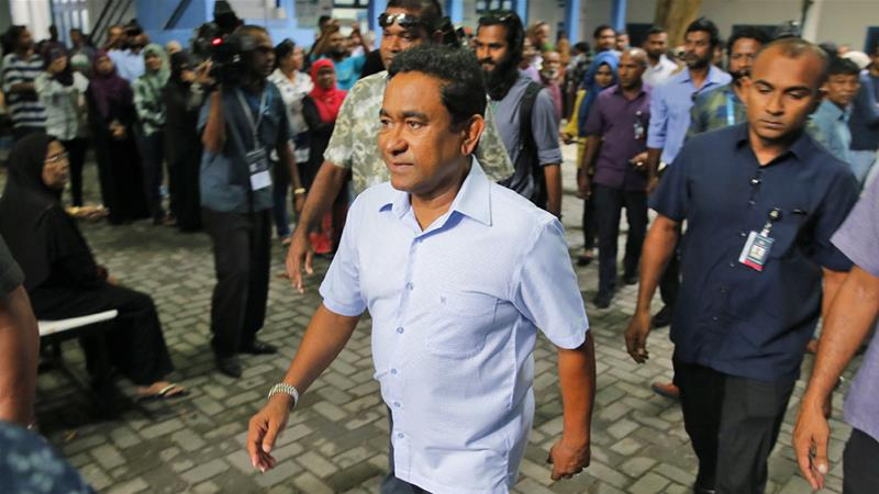 President Abdulla Yameen leaves a polling station after casting his vote on Sunday [Eranga Jayawardena/AP]