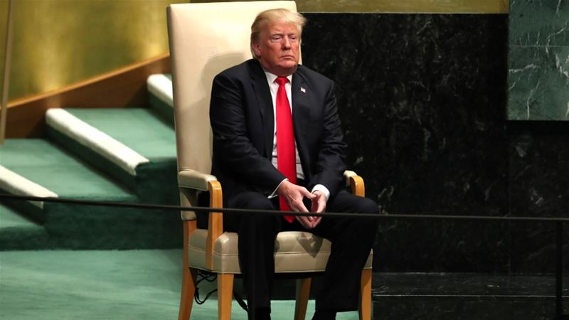 US President Donald Trump sits in the chair reserved for heads of state before delivering his address during the 73rd session of the United Nations General Assembly on September 25, 2018 [Reuters]